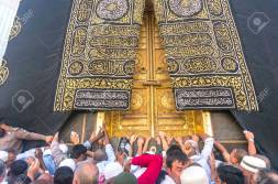 MAKKAH - MAR 14 : A close up view of kaaba door and the kiswah (cloth that covers the kaaba) at Masjidil Haram on March 14, 2015 in Makkah, Saudi Arabia. The door is made of pure gold.