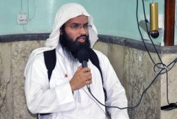 In this undated image obtained from a militant website on Dec. 12, 2014, Turki al-Binali, a Bahraini citizen who is also known among jihadis by two other names: Abu Sufian al-Silmi and Abu Hummam al-Athari, gives a lecture to dozens of worshippers and jihadi fighters inside a mosque in the northern Iraqi city of Mosul during the Muslim holy month of Ramadan in mid-2014. Al-Binali has risen in the ranks of the Islamic State group to become one of its top and most influential religious figures. (AP Photo)
