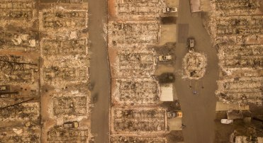 In this aerial photo, a burned neighborhood is seen in Paradise, California, on November 15, 2018. - The toll in the deadliest wildfires in recent California history climbed to 59 on November 14, 2018, as authorities released a list of 130 people still missing. (Photo by Josh Edelson / AFP) (Photo credit should read JOSH EDELSON/AFP/Getty Images)