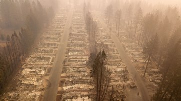 In this aerial photo, a burned neighborhood is seen in Paradise, California on November 15, 2018. - The toll in the deadliest wildfires in recent California history climbed to 59 on November 14, 2018, as authorities released a list of 130 people still missing. (Photo by Josh Edelson / AFP) (Photo credit should read JOSH EDELSON/AFP/Getty Images)